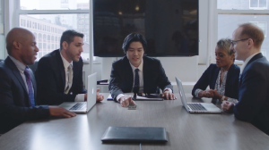 Flyp featured users in a conference room on a real estate call.