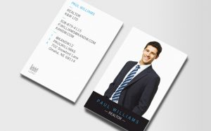 Business cards with a professionally dressed man on them.